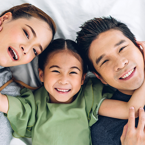 family with healthy teeth after visiting family dentistry
